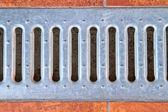 Lattice of the storm water drain — Stock Photo