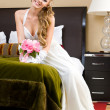 Beautiful bride in the bedroom with luxurious interior — Foto Stock