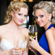 Bride and her Bridesmaid in a restaurant - Stock Photo