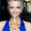 Beautiful woman with a glass of wine - Stock Photo
