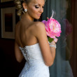 Beautiful bride with bunch of flowers. — Stock Photo