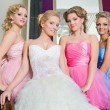 Stock Photo: Bride with her bridesmaids on stairs