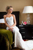 Beautiful bride in the bedroom with luxurious interior — Stock Photo