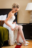 Beautiful bride on the bed — Stock Photo