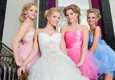 The bride with her bridesmaids on the stairs — Stock Photo