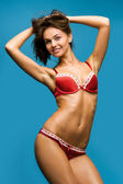 Beautiful woman in the red underwear. — Stock Photo