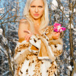Beautiful blonde with naked shoulders in the winter forest — Stock Photo #7826592