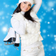 Stock Photo: Beautiful woman in winter white clothes with skates.