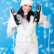 Beautiful woman in winter white clothes with skates. — Stock Photo