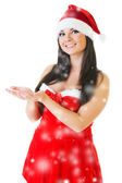 Beautiful woman in masquerade fashion and santa hat — Stock Photo