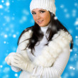 Stock Photo: Beautiful woman in winter fashion with snowball.