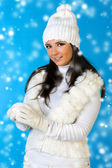 Beautiful woman in winter fashion with snowball. — Stock Photo