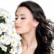Beautiful woman with closed eyes and flowers — Stock Photo