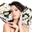 Woman with flowers in hair — Stock Photo #6836333
