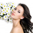 Beautiful woman with flowers — Stock Photo #6836460