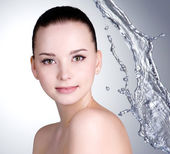 Beautiful woman with clean skin and water — Stock Photo