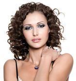 Young woman with fashion makeup and curly hai — Stock Photo