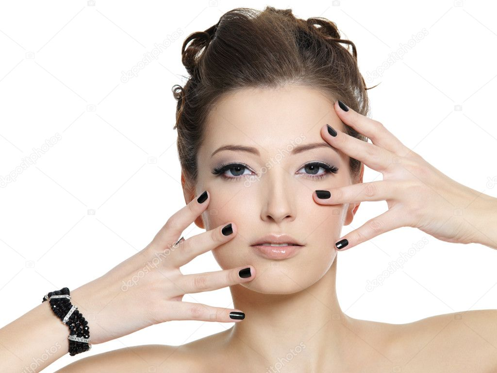 Beautiful glamour young woman with black manicure  posing on white background  Stock Photo #6837245