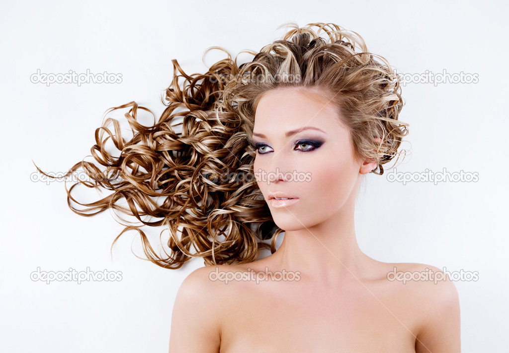Beautiful  young woman with long curly hair — Stock Photo #6838909