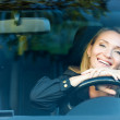 Smiling pretty woman in the new car — Stock Photo #7243718