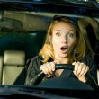 Fright face of woman driving car — Stock fotografie