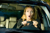 Fright face of woman driving car — Stock Photo