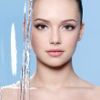 Face of woman with stream of water — Stock Photo