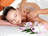 Spa massage on a shoulder for young beautiful woman — Stock Photo