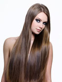 Beauty of long healthy hair of young woman — Stock Photo
