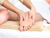 Relaxing massage on the foot in spa salon — Stock Photo