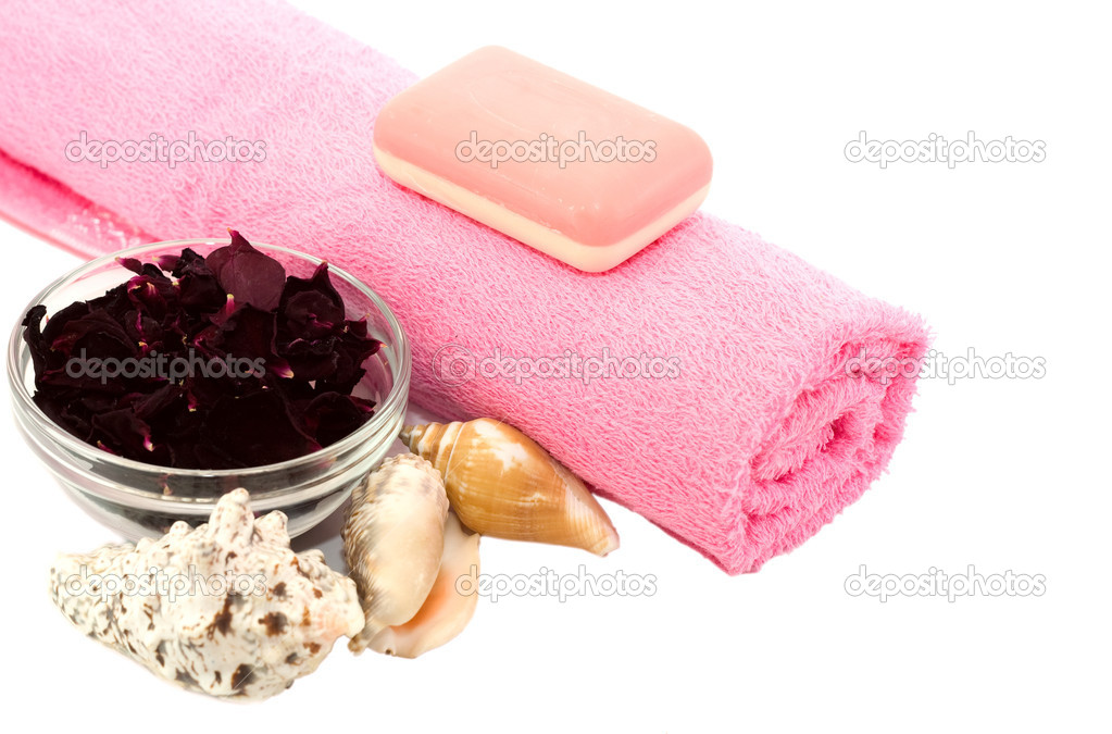 Pink towel and soap with shells and rose petals isolated on a white background. — Stock Photo #6897897