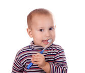 Boy brushing his teeth after bath — Stock Photo