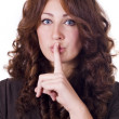 Stock Photo: Woman Making Silence Gesture