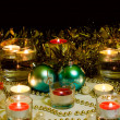Stock Photo: Festive mood. Candles, Christmas toys