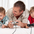 Happy family playing a video game — Stock Photo #6758806