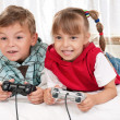 Happy girl and boy playing video game — Stock Photo #6777533
