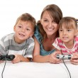 Stock Photo: Happy family playing a video game