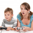 Happy family playing a video game — Stock Photo #6893062