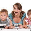 Happy family playing a video game — Stock Photo #6934526