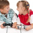 Happy girl and boy playing a video game — Stock Photo #7051279
