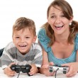 Happy family playing a video game — Stock Photo #7051473