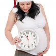 Pregnant woman with clock — Stock Photo