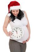 Mujer embarazada con reloj — Foto de Stock