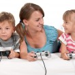 Happy family playing a video game — Stock Photo #7129074