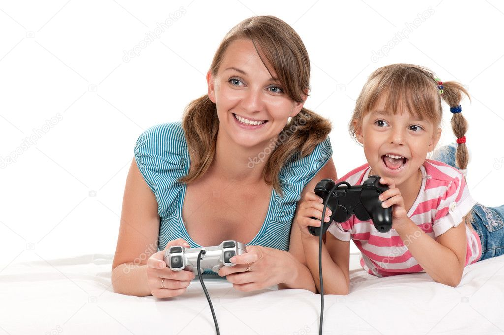 Happy family - mother and child playing a video game — Stock Photo #7128998