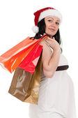 Hamile kadın ile alışveriş torbaları — Stok fotoğraf