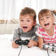 Happy girl and boy playing a video game — Stock Photo #7536177