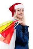 Mujer de navidad con bolsas de compras — Foto de Stock