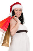 Pregnant woman with shopping bags — Stock Photo