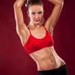 Young fit woman lifting dumbell — Stock Photo